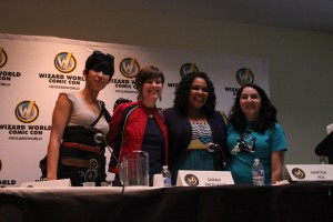Group of super heroines presenting on geek feminism to a comic convention.